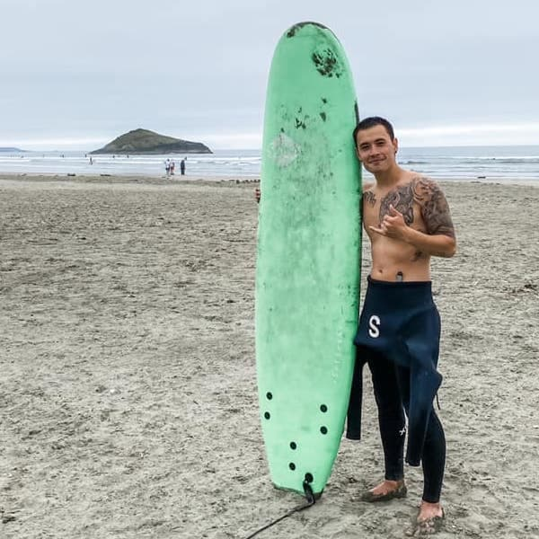 Anthony Surfing in Tofino - Sarah Griffiths Hu